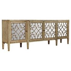 """Perfect for displaying a lush floral arrangement or stowing board games and DVDs, this handsome credenza showcases 4 mirrored doors with fretwork overlay.            Product: Credenza    Construction Material: Hardwood solids, oak wood veneers and mirrored glass     Color: Natural and silver   Features:   Distressed finish   Four doors One interior adjustable shelf Magnetic door closure    Dimensions: 38"""" H x 105"""" W x 20"""" D    Cleaning and Care: Wipe with a damp clothAssembly: Assembly ..."""