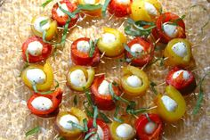 Take each mozzarella ball and wrap with a strip of pepper. Secure with a toothpick and place on serving platter. Repeat with remaining peppers and cheese. Slice some fresh basil, if you like, into chiffonade and sprinkle over the appetizers.
