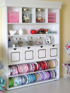 I would love to have a room for just crafts and a shelf like this....