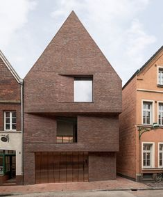 hehnpohl architektur's residential 'haus am buddenturm' is nestled among the heritage fabric buildings of münster, historic city… Brick Architecture, Contemporary Architecture, Interior Architecture, Contemporary Houses, Roof Design, Facade Design, House Design, Staircase Design, Design Art
