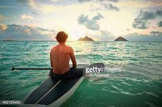 Stock-Foto : Caucasian man on paddle board in ocean