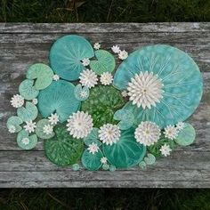 Handmade ceramic Lily pad coaster, emerald green, light Spring green, leaf green or dark green with speckles. Please select number of pieces and colours. See photos for colour choices. I cut the lily pad shapes freehand with a potters pin, carve the leaf veins, biscuit fire then