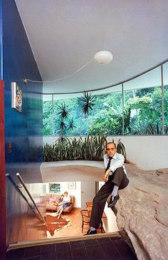 Oscar Niemeyer: Niemeyer sits on a rocky ledge at his self-designed home in Brazil