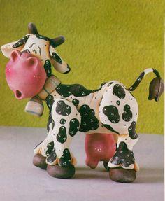 Adorno de vaca en porcelana al frio