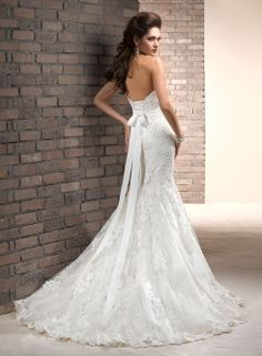 Maggie Sottero Charisse Bridal Gown.  I like the lace up back, but I am really not into the strapless gowns.  They just don't look good on me.