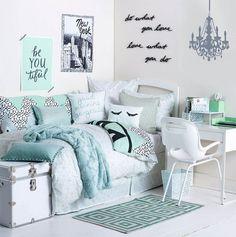 Teal, pale blue, and white dorm room bedroom design