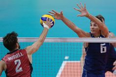 Italy's Simone Giannelli jumps up to block the