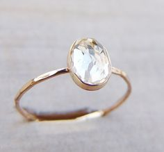 white topaz and gold ring - 19 more ideas for affordable, minimalist rings on the page!