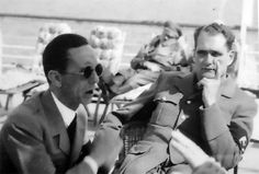 A slightly surreal picture of Josef Goebbels and Rudolf Hess at Berchtesgaden, with Hitler napping in background.