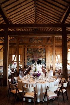 Indoor rustic elegant reception w/ purple floral accents, Brinton Studios at Devils Thumb Ranch, Colorado Wedding Co.