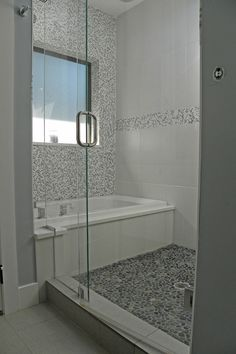 round out the tub, foggy glass doors and window (open from top), darker tiles. more of a lip from the shower.
