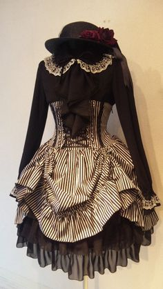 i like lolita fashion but honestly i find some of the outfits look wayyy too cutesy. i could never pull them off. but THIS dress though... :3 i like it and i wish i had it