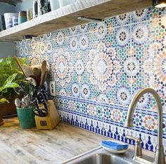 Moroccan tile backsplash with floating shelf, maybe a solid-surface counter