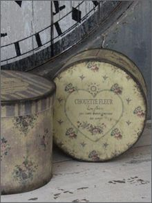 Vintage Boxes - perfect for storage, these boxes could be made by covering craft store boxes with vintage looking paper and Mod Podge, then aged with an antiquing glaze - via The Elegant Chateau: A Cozy Weekend