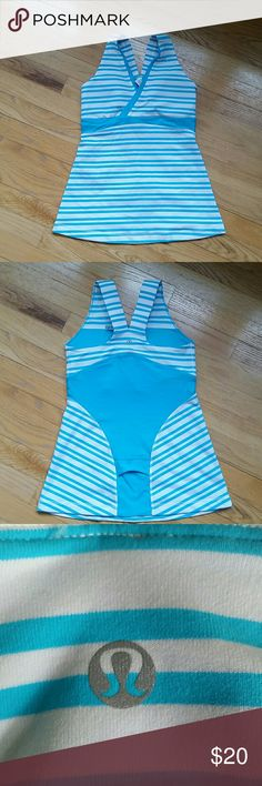 Lululemon Deep V bra top Size 6 *New w/o tags New* w/out tags.  Cross front tank Turquoise and white stripe tank with wide straps.  Solid color mesh back panel with hidden pocket. Bra top with removable  pads lululemon athletica Tops Tank Tops
