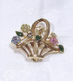 Vintage Sparkly Rhinestone Brooch Flower Basket Flower Blue Gold Pink Green via Etsy