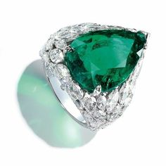 Piaget Fine Jewelry collection in 18K white gold set with 1 Pear Cut Colombian Emerald (12.06 cts), 47 MarquiseCut Diamonds (7.08 cts) and 88 BrilliantCut diamonds (0.17 ct)