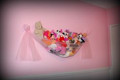 obviously need a more masculine version, but a cute way to hang stuffed animals in Jax's nursery