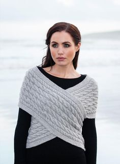 Fisherman Aran Cable Wrap in Wool & Cashmere - Stunning, comfortable aran cable wrap sweater. This traditional woman's diagonal wrap aran sweater is available in three different colors. With side button fastening, and off the shoulder sleeves, this wrap is a practical and warm addition which can be worn year round.
