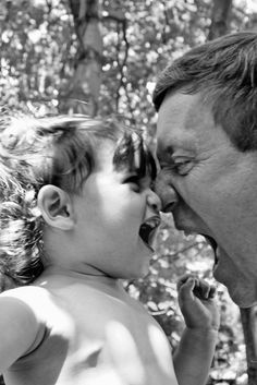 This is my 18 month old granddaughter with her grandfather. Neither one will back down.  She has the heart of a lion and loves to roar back.