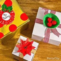 """Make wrap-sterpieces with plain boxes and party supplies - think gumball """"holly,"""" baking cup poinsettias and lovely labels! Click for these DIY Christmas gift wrap ideas and much more!"""