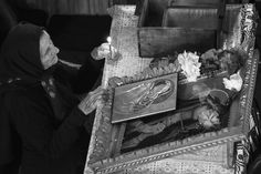 'The Sunday Service' by Alecsandra Dragoi      An elderly Romanian woman worships at a Christian Orthodox church.  In pictures: 2014 Faith Through A Lens photography competition