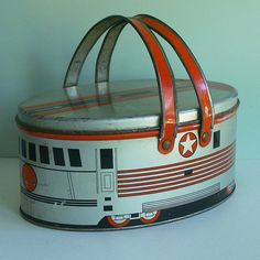 | Small Oval Lunch Box or Picnic Tin with an Art Deco Train Design