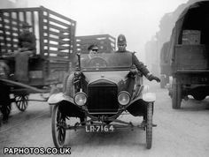 British Law and Order - Police - Vehicles - London - 1920 Police use a Ford Model T car to regulate slow moving traffic in the East End of London.