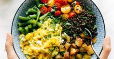 Sunshine Lentil Bowls with healthy summer produce like green beans, tomatoes, herbs, roasted potatoes, lentils, goat cheese, and soft scrambled eggs.