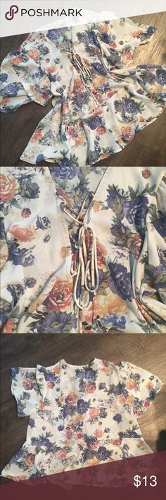 Floral Blouse🌸 Beautiful blouse from urban outfitters, only worn once! It is in perfect condition. Lace up v-neck, 100% polyester. Marked a size L but fits more like a M. Open to offers! Kimchi Blue Tops Blouses