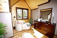 We love love love this upstairs bedroom! With the Classic lines of a log home, the beautiful wood walls and floors, contrasting trim and a perfectly placed window, every morning is certain to be a good one! www.timberblock.com