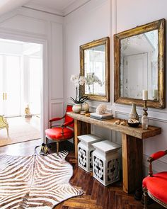 love the double square mirrors with the double square stools...
