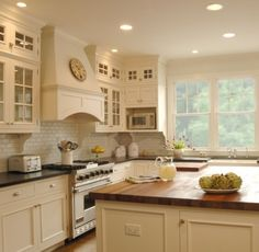 granite for off white kitchens | Off-white painted cabinets, black granite countertops, butcher block ...