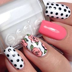 """""""Mix n match spring time mani. I used Butter London's """"trout pout on my middle finger. I free-handed the flowers on my finger using Butter London's…"""""""