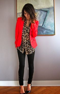 Shop this look on Lookastic: https://lookastic.com/women/looks/red-blazer-beige-button-down-blouse-black-skinny-pants-black-pumps/13051 — Red Blazer — Beige Leopard Button Down Blouse — Black Studded Skinny Pants — Black Leather Pumps