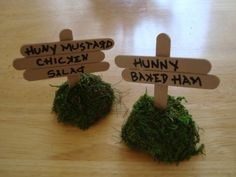 """Table Labels - Jen's Classic Pooh baby shower. Looks like floral """"stuff"""" with moss glued to it and small popscicle sticks. Another trip to JoAnn's"""