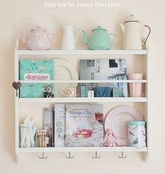 Create an adorable kitchen display (even in a small kitchen!) by placing tea pots, cookbooks and more on an IKEA STENSTORP plate shelf!