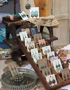 The earring tray is a small wooden drawer with dividers that happen to be the perfect size for carded earrings.  Part of my display from the Strawberry Swing Indie Craft Festival held on June 1st & 2nd, 2012.