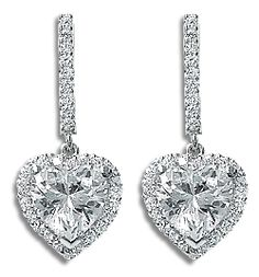 Pave Heart with Halo of Rounds CZ Drop Earrings, 4.5 Ct TW by Mystique... These fantabulous drop earrings feature an elegantly long bar of micro pave rounds with a 2.0 carat each cubic zirconia heart drop with micro pave halo. Approximately 4.5 carats total weight, these earrings measure 1 1/16 inches (27.0mm) from top to bottom. Available in 14K white gold or 14K yellow gold. Model: 5130H2, $925.00  Mystiquegems.com Jewelry