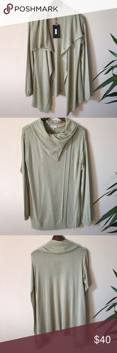 The Limited Cardigan Green NWT STUNNING Scandal Collection by The Limited cardigan with unique closure option. Wear open for a relaxed topper or closed by way of two buttons on either side of the neckline for a more polished, professional style. Gorgeous silky, sleek - touch of cashmere - fabric gives this piece a stunning drape. MAKE AN OFFER Handwash 50% Viscose 45% Nylon 5% Cashmere The Limited Sweaters Cardigans