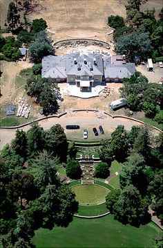 Oprah Winfrey - Seems the queen of daytime TV is also the queen of real estate (and the queen of about a million other things!). Oprah Winfrey owns this beautiful, 42-acre, 23,000-square-foot Montecito, Calif., estate, complete with barn, gardens, an orchard, two ponds and a lake. She paid an estimated 50 million dollars for it, which the Los Angeles Times reported is one of the highest amounts ever paid for a private home in the U.S.