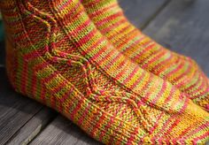 This pattern is my solution to the variegated yarn conundrum - that one where a gorgeous skein of yarn refuses to knit well in a pattern, but the thought of yet another totally stockinette sock is too monotonous to bear. Beginner Knitting Patterns, Knitting Designs, Knit Patterns, Non Slip Socks, Lace Socks, Knitting Socks, Hand Knitting, Knit Socks, Knitted Slippers