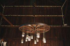 Wagon wheel + mason jar chandelier
