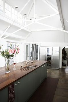 lofted ceilings with multi-level windows, bright, and wood counters...not as 'cozy' as I would like, but it has elements that could work in other rooms, too....