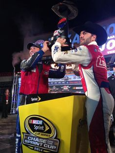 CC Chad Knaus and @JimmieJohnson hoist the #AAATexas500 trophy!  (Twitter: Team Lowe's Racing ‏@LowesRacing)