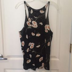 "Vintage soft Brandy Melville black daisy tank 90s This tank is so soft and comfortable. It has that vintage / worn in vibe. Cute daisy print covers it. It is Brandy Melville so ""one size fits most"" ...but I would say it's more of a medium, could fit a small but would be more of a loose fit. Has kind of an early 90s vibe. Check out my other listings and feel free to bundle!  Brandy Melville Tops Tank Tops"