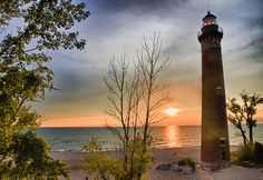 Little Sable Point Light on Lake Michigan. Located near White Hall, Michigan in Silver Lake Sand Dunes State Park. Built in 1874, the 107-foot high tower is known as a 'Poe Lighthouse', after its designer Orlando Poe. [photo: Jason Mrachina]