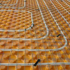 Underfloor radiant heating - runs off myriad energy sources and is much more efficient than air-circulating heaters.