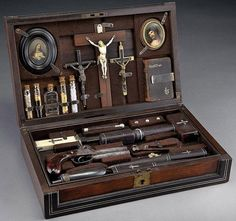 WOW! I've always wanted one of these! Real Vampire Kit from 1800's -- Cased vampire killing kit, in a rosewood and ebony case with inlaid silver stringing and mother-of-pearl inlaid plaque.