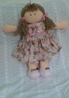Boneca com vestido floral
